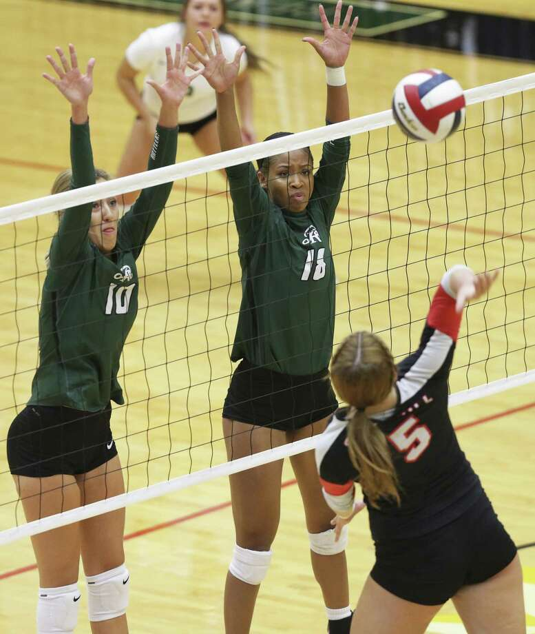 Tall defense is presented as Nika Burja (10) and Kyla Waiters go up to block a shot by the Chargers' Cate Buckingham as Reagan beats Churchill 3-1 in volleyball at BAC on September 12, 2017. Photo: Tom Reel, Staff / San Antonio Express-News / 2017 SAN ANTONIO EXPRESS-NEWS