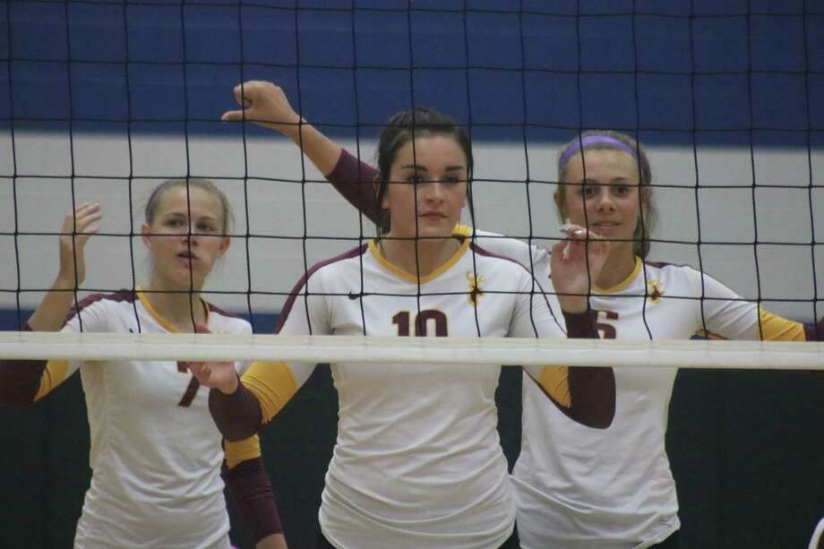 From left to right, Hannah Baker,  Emma Aillet and Courtney Plocheck wait for the next ball to sail over the net during Tuesday's night district match with Sam Rayburn. Photo: Robert Avery