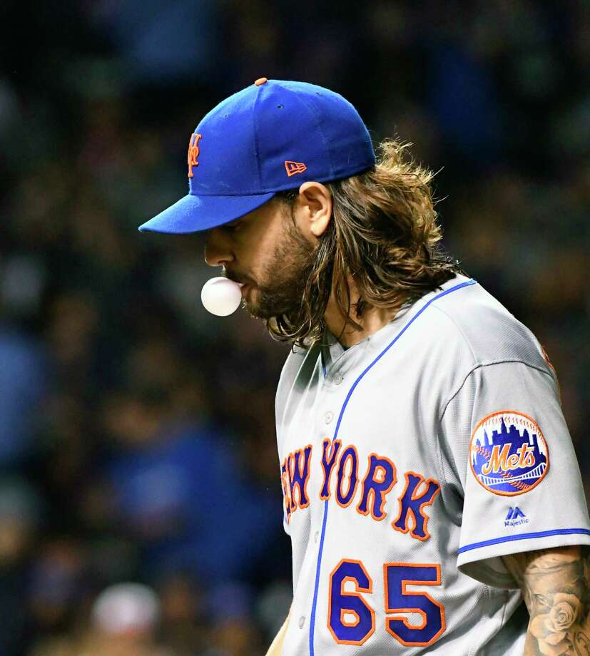 New York Mets starting pitcher Robert Gsellman (65) blows a bubble after pitching against the Chicago Cubs during the fourth inning of a baseball game in Chicago, Tuesday, Sept. 12, 2017. (AP Photo/Matt Marton) ORG XMIT: CXC122 Photo: Matt Marton / FR170980 AP
