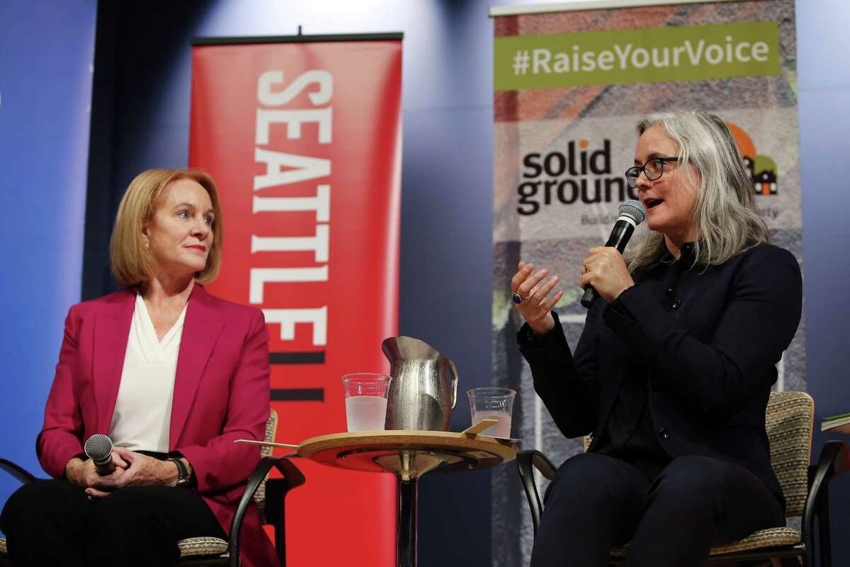 Mayoral candidates Jenny Durkan, left, and Cary Moon ask each other questions during a debate, Tuesday, Sept. 12, 2017 at Seattle University.