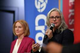 Mayoral candidates Jenny Durkan, left, and Cary Moon answers questions during a debate, Tuesday, Sept. 12, 2017 at Seattle University.