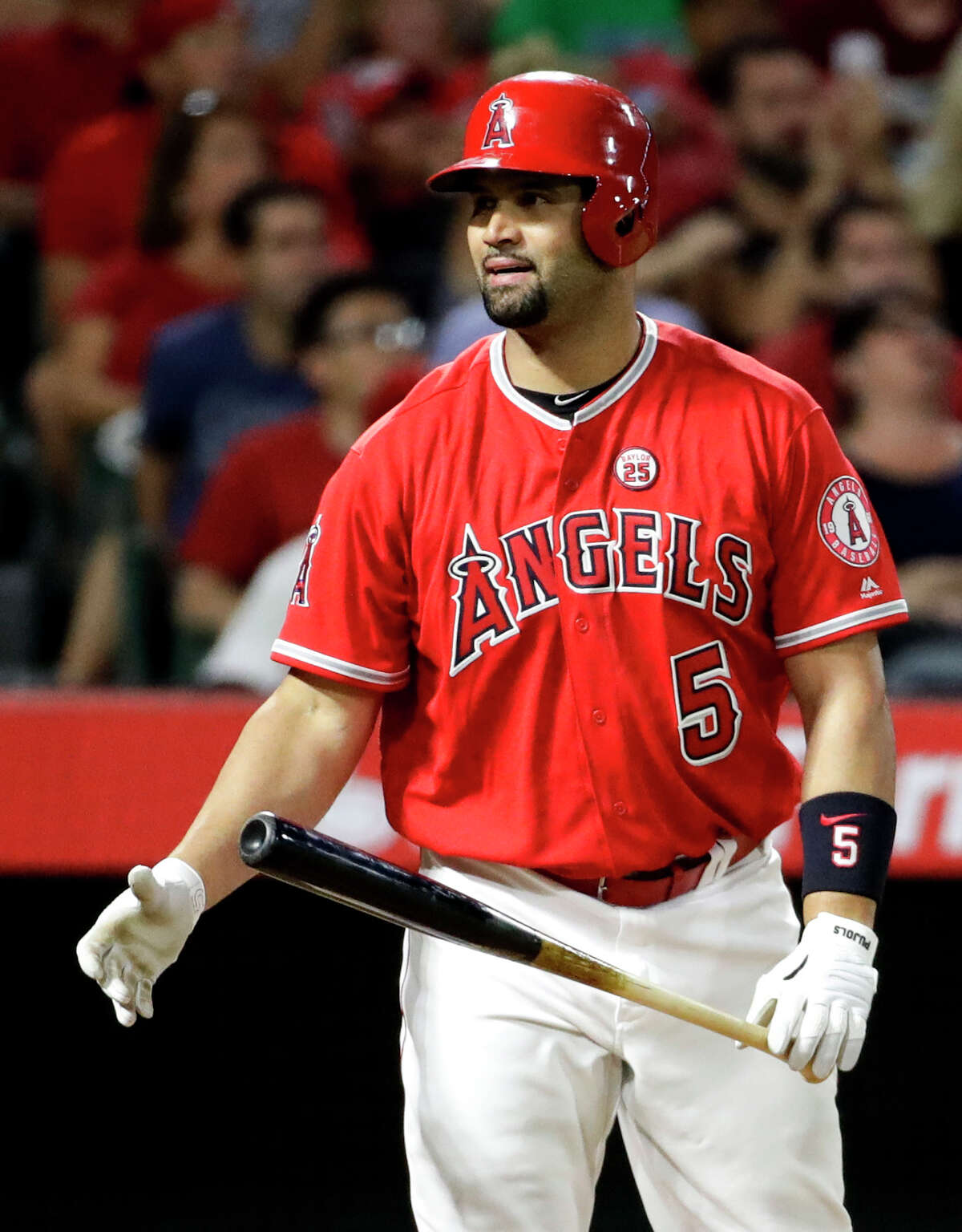 Los Angeles Angels' Albert Pujols reacts after flying out against the Houston Astros during the seventh inning of a baseball game in Anaheim, Calif., Tuesday, Sept. 12, 2017. (AP Photo/Chris Carlson)