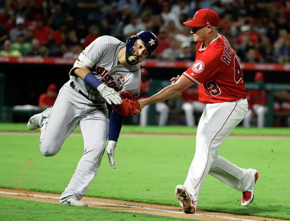 Los Angeles Angels starting pitcher Garrett Richards, right, tags out Houston Astros' Marwin Gonzalez during the fourth inning of a baseball game in Anaheim, Calif., Tuesday, Sept. 12, 2017. (AP Photo/Chris Carlson)