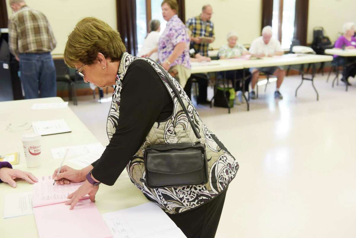 Milton Supervisor candidate Barbara Kerr signs the election book as she votes at the Milton Community Center on Tuesday, Sept. 12, 2017, in Milton, N.Y. (Paul Buckowski / Times Union)