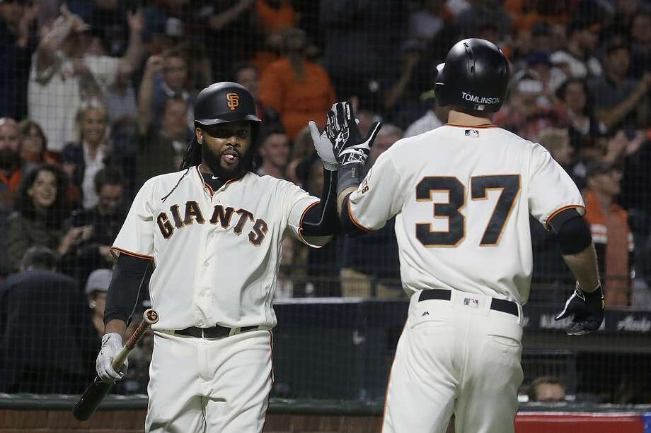San Francisco Giants' Kelby Tomlinson, right, is congratulated by Johnny Cueto after hitting a solo home run against the Los Angeles Dodgers during the third inning of a baseball game in San Francisco, Tuesday, Sept. 12, 2017. (AP Photo/Jeff Chiu) Photo: Jeff Chiu, Associated Press