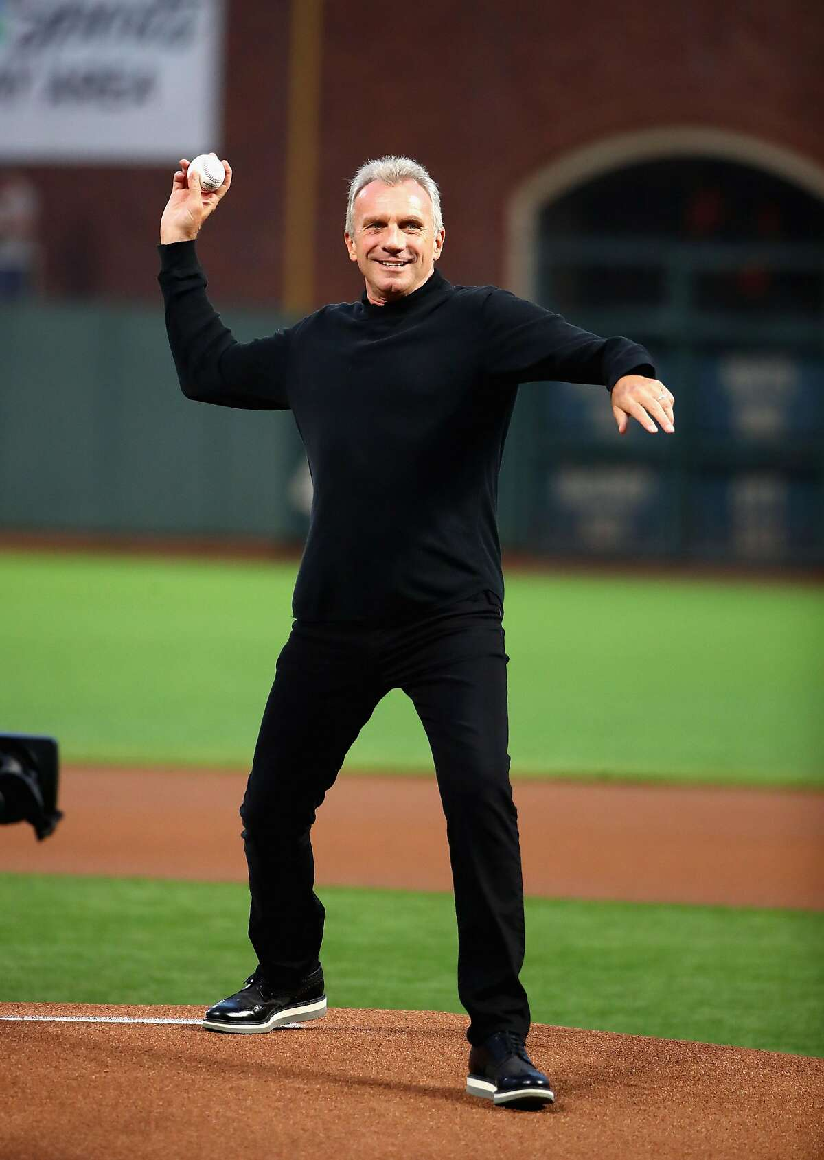 SAN FRANCISCO, CA - SEPTEMBER 12: Former NFL quarterback Joe Montana throws out the ceremonial first pitch before the San Francisco Giants game against the Los Angeles Dodgers at AT&T Park on September 12, 2017 in San Francisco, California. (Photo by Ezra Shaw/Getty Images)
