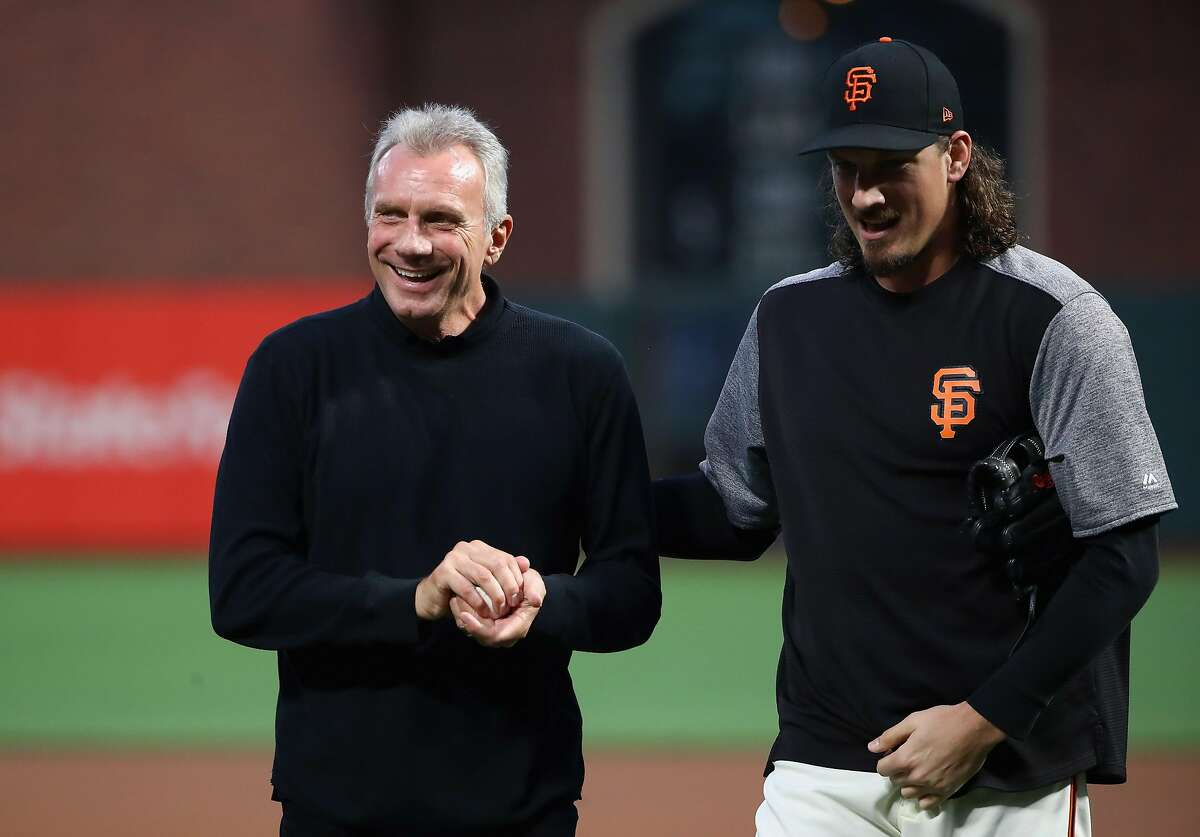 SAN FRANCISCO, CA - SEPTEMBER 12: Former NFL quarterback Joe Montana walks off the field with Jeff Samardzija #29 of the San Francisco Giants after he threw out the ceremonial first pitch before the San Francisco Giants game against the Los Angeles Dodgers at AT&T Park on September 12, 2017 in San Francisco, California. (Photo by Ezra Shaw/Getty Images)
