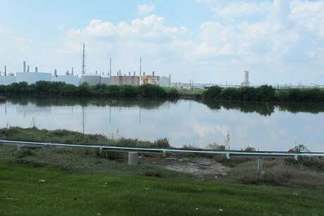 This Saturday, Sept. 2, 2017 photo shows the heavily polluted Patrick Bayou in the Houston Ship Channel that was flooded during Tropical Storm Harvey in Houston.  The bayou, which sits next to a chemical plant in an intensely industrial area of Houston, is polluted with pesticides, hydrocarbons, metals and polychlorinated biphenyls (PCBs).  Floodwaters have inundated at least five highly contaminated toxic waste sites near Houston, raising concerns that the pollution there might spread. (AP Photo/Jason Dearen)