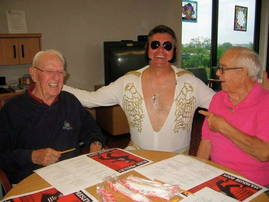 Elvis, also known as Doug Temple, laughs with Bud Irish and Buck Last at Riverside Place in Midland. Elvis showed up at Riverside's monthly picnic, which was moved indoor from Emerson Park because it was raining. The picnic was Elvis-themed. (Photo provided)