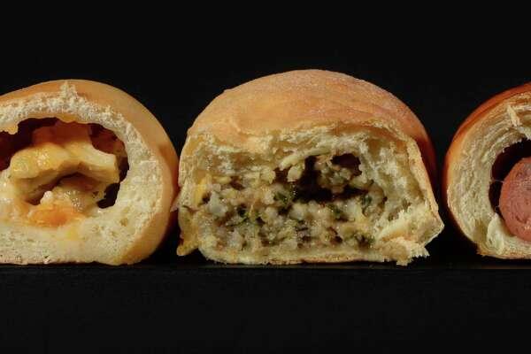 From left, Kolache Factory's Italian chicken kolache, Daviss Donut's boudin kolache, Tasty Cream's jalapeño kolache. Photo taken Wednesday, February 11, 2015 Guiseppe Barranco/The Enterprise