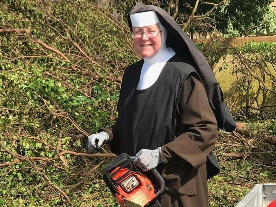 Sister Margaret Ann was spotted at work, chainsaw in hand, by an off-duty officer of the Miami-Dade Police Department. The department shared video of the sister in action. See more photos of the recovery effort in Florida after Irma... Photo: Miami-Dade Police Department