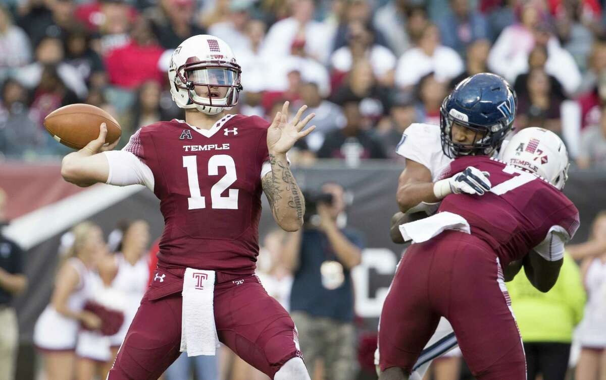 PHILADELPHIA, PA - SEPTEMBER 09: Logan Marchi #12 of the Temple Owls throws a pass in the fourth quarter against the Villanova Wildcats at Lincoln Financial Field on September 9, 2017 in Philadelphia, Pennsylvania. The Owls defeated the Wildcats 16-13.
