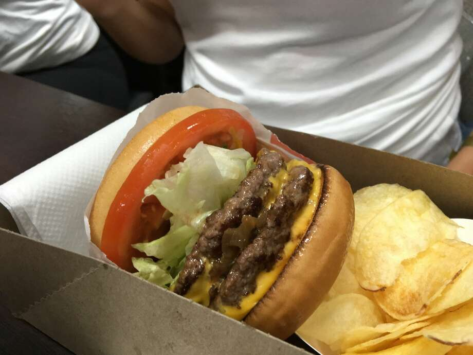 Southern Californian burger chain In-n-Out Burger€™ opened a pop up restaurant in Swiss Cottage, London. Burger fans were queuing from 9 am for a chance to experience the cult burger in 2016. The reasoning behind the pop-ups are more of a legal issue, sources are reporting. Photo: Ming Yeung/Getty Images Europe