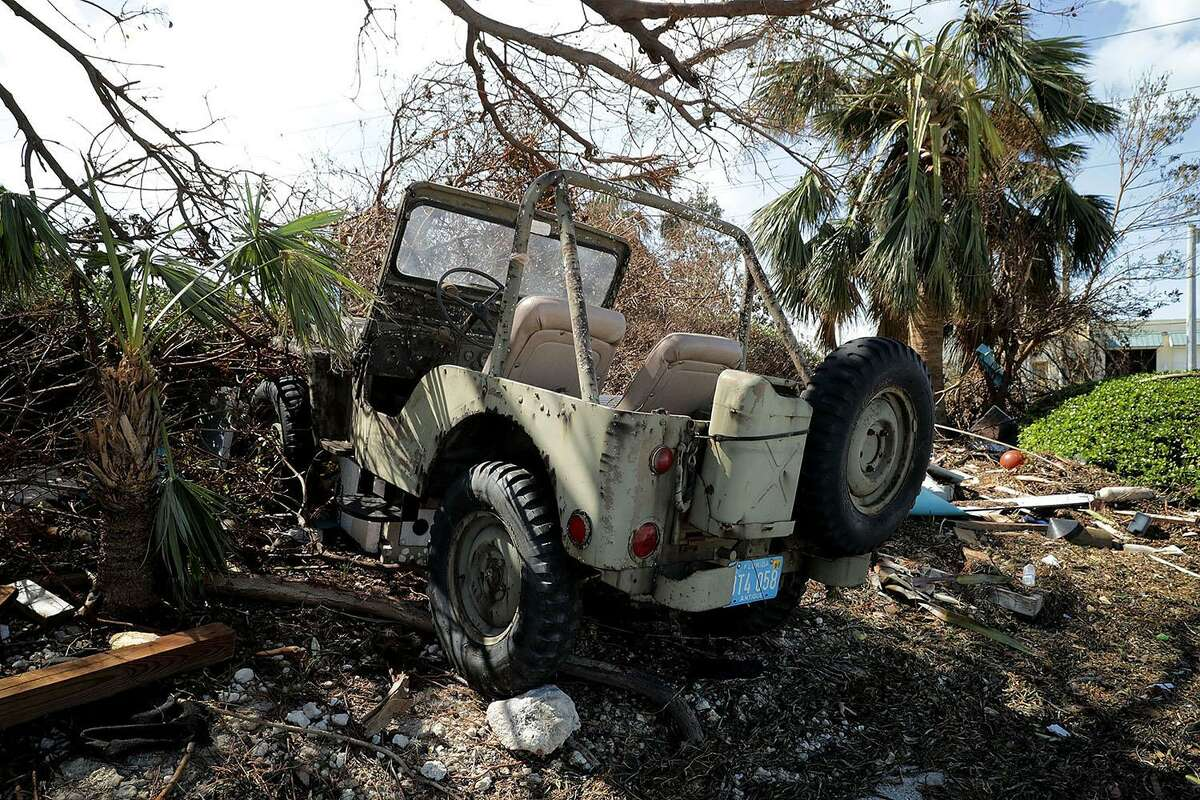 MARATHON, FL - SEPTEMBER 12: A jeep destroyed by hurricane storm surge water sits in a yard two days after Hurricane Irma slammed into the state on September 12, 2017 in Marathon, Florida. The Federal Emergency Managment Agency has reported that 25-percent of all homes in the Florida Keys were destroyed and 65-percent sustained major damage when they took a direct hit from Hurricane Irma. (Photo by Chip Somodevilla/Getty Images)