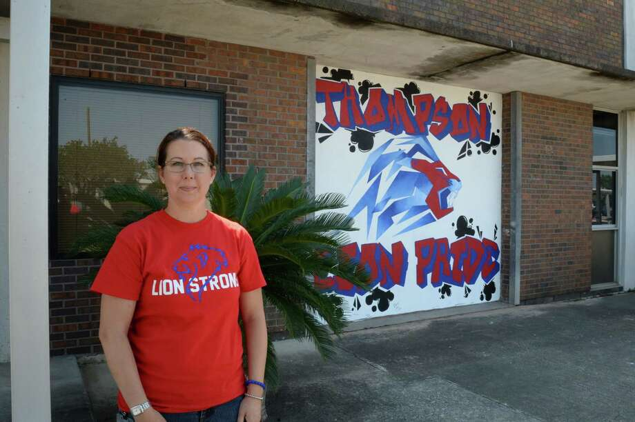 "Thompson Intermediate School Principal Melissa Allen stands in front of a mural created by Beverly Hills Intermediate School staff members. ""The kids were so excited to be back at school,"" she said. ""They're looking for some stability."""