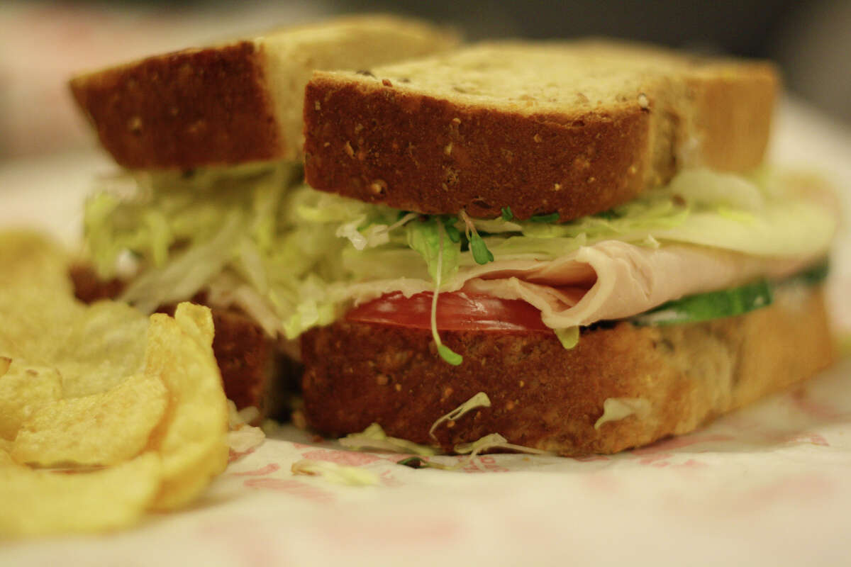 The Beach Club sandwich on seven grain bread from Jimmy John's in Washington D.C., one of the popular sandwich chain's more exciting menu items. (Photo by Alex Baldinger/The Washington Post via Getty Images) The restaurant opened its first store in the college town of Charleston, Illinois,according to Jimmy John's official website.