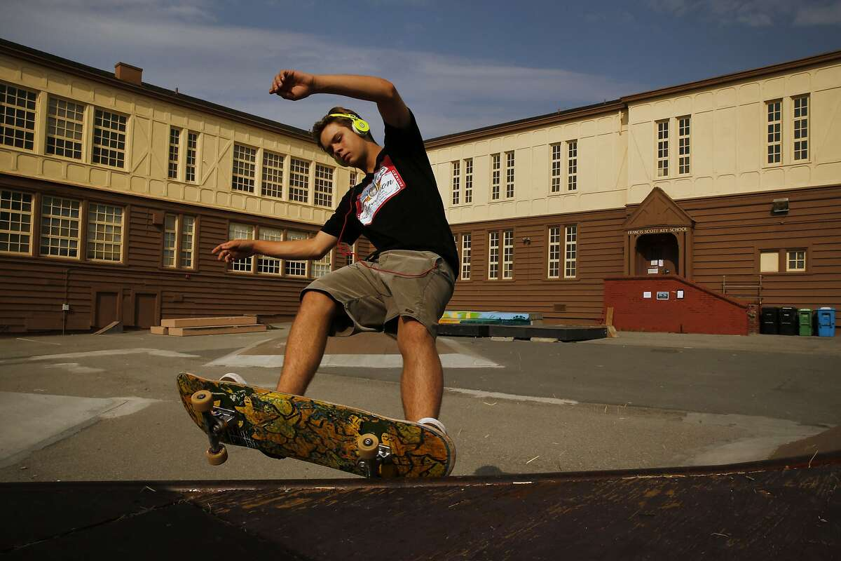 """London Horwood rides his skateboard at the Francis Scott Key Annex on Wednesday, Sept. 6, 2017, in San Francisco, Calif. City and school district officials are considering tearing down this site located at 1360 43rd Ave to build apartment units for teachers and other educators to help address the """"housing crisis"""" in S.F. Currently, it's an open space used by families and others in the community."""