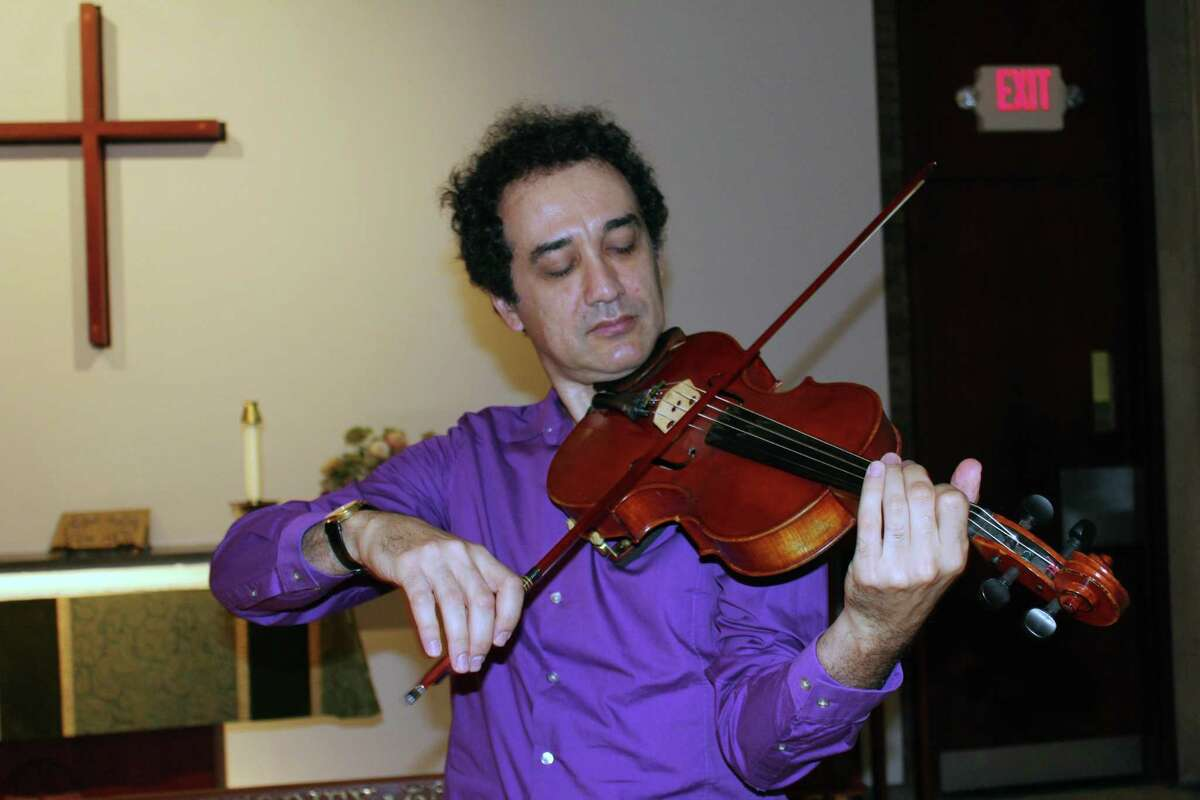 The violinist and violist Yaroslav Kargin playing his viola in the chapel of St. Mark's Episcopal Church in New Canaan on Sept. 6.