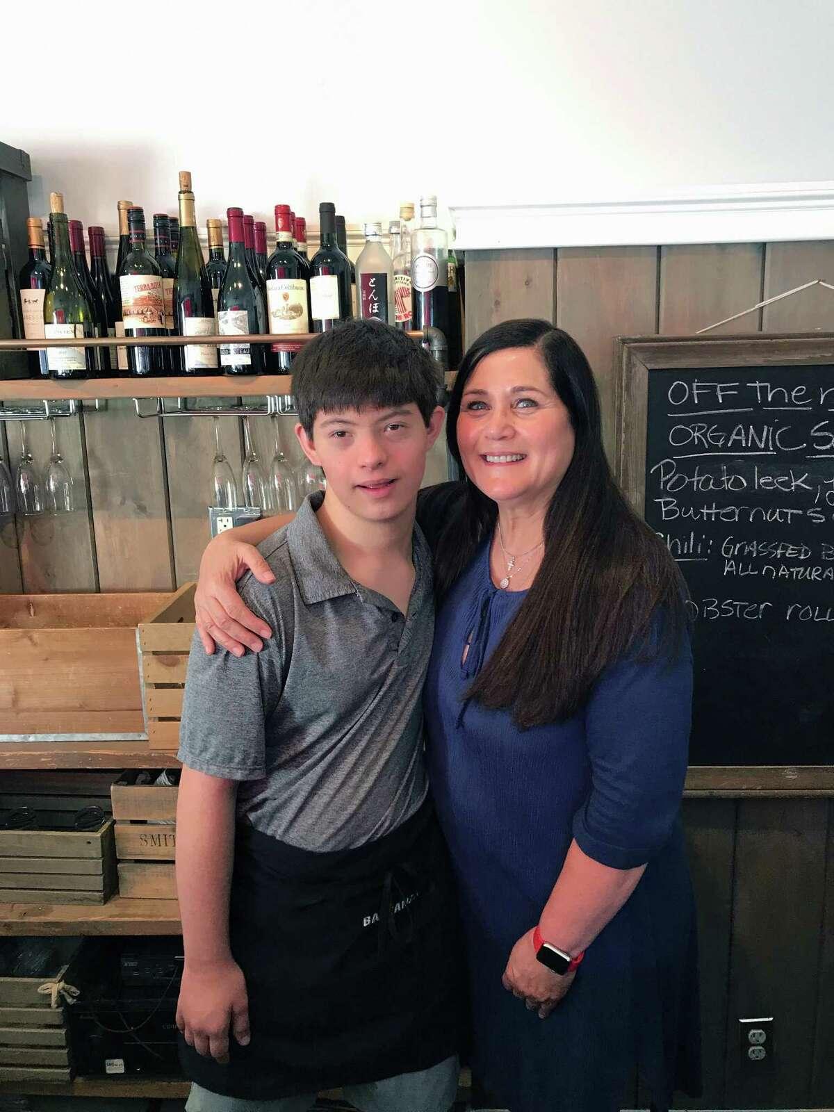 Angela Baldanza and New Canaan High School junior Patrick Dewitt, who works at Baldanza Cafe in New Canaan, Conn.