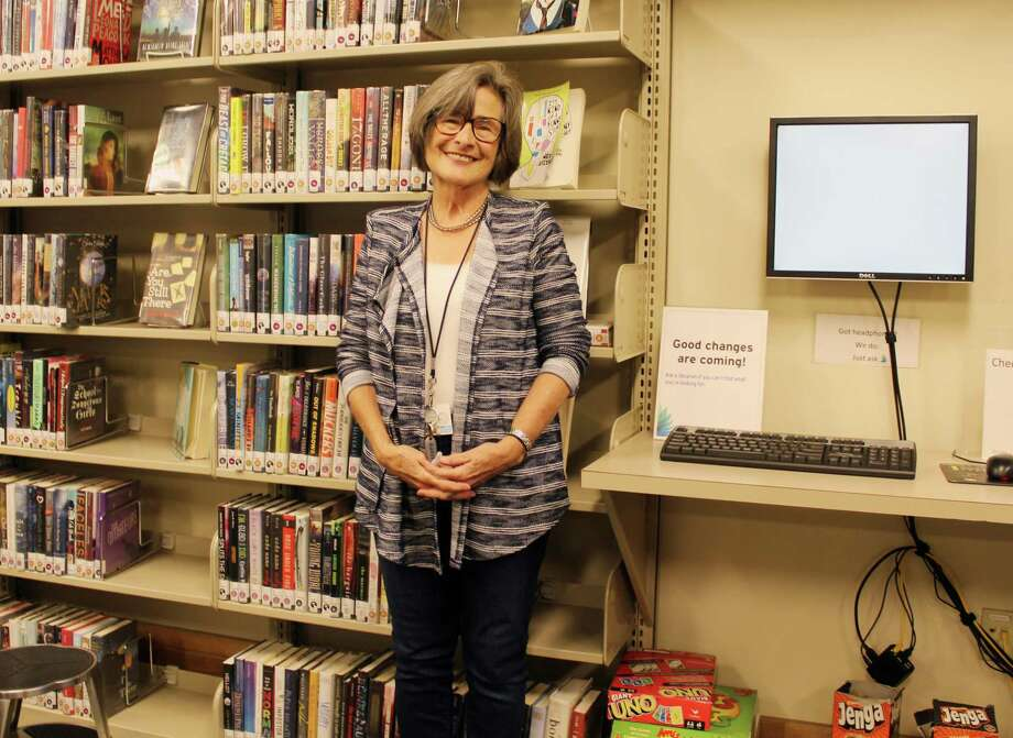 Lynda Sorensen, an English teacher at Darien High School, at the teen lounge in the Darien Library which is home to the new alternative high school program, Fitch Academy. Photo: Erin Kayata / Hearst Connecticut Media / Darien News