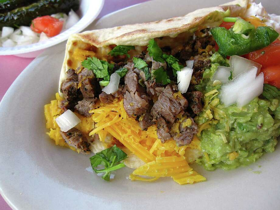 Fajita taco with guacamole, sour cream and cheese on a handmade flour tortilla from Chacho's on Callaghan Road in San Antonio. Photo: Mike Sutter /Staff File Photo