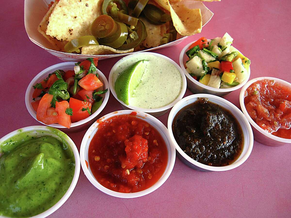 Salsa, pico de gallo, jalapeños and chips from the salsa bar at Chacho's.