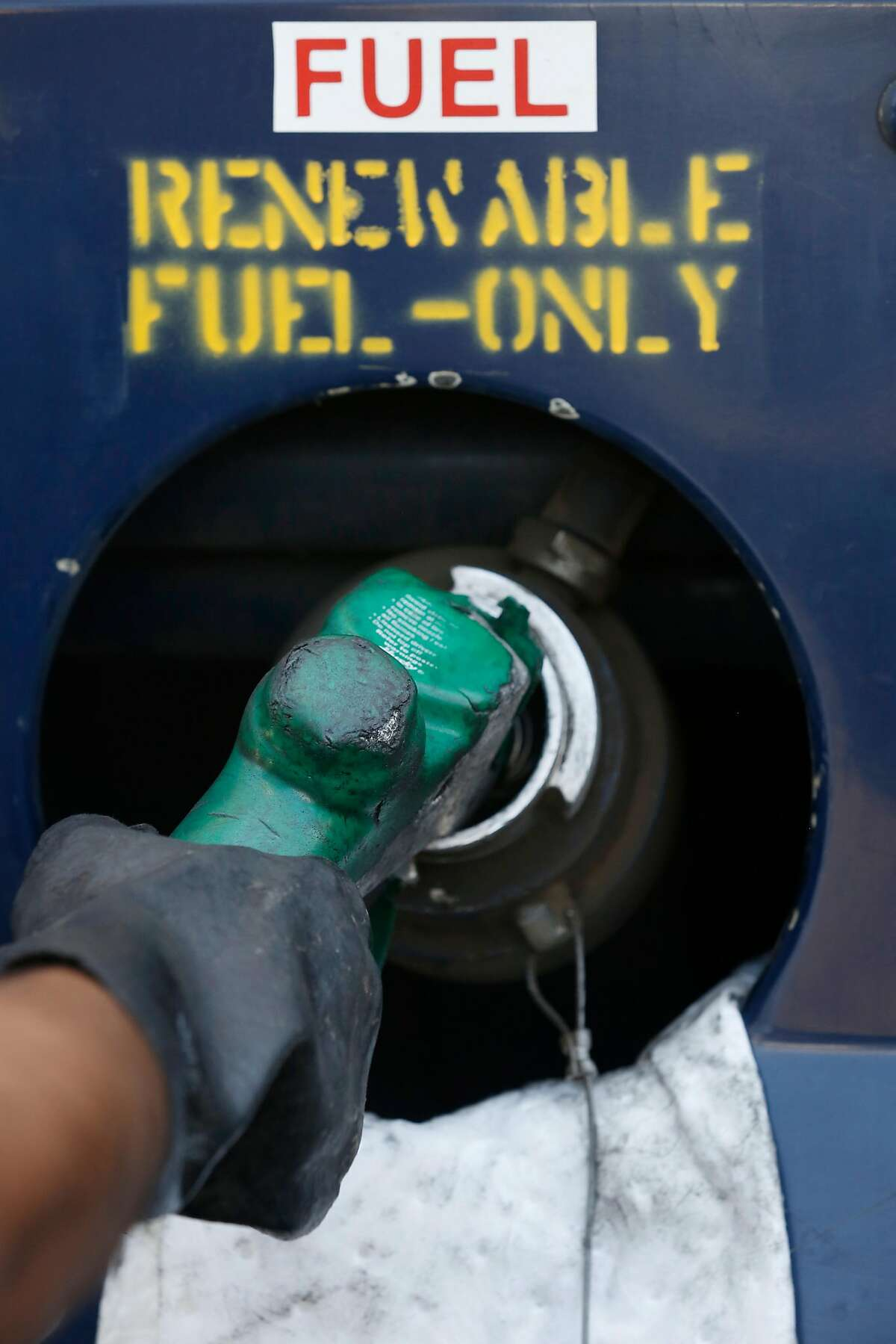Oscar Muro, Golden Gate Petroleum trainer, fills a Capital Corridor locomotive with rewnewable diesel at the Amtrak Maintenance Facility on Tuesday, September 12, 2017 in Oakland, Calif.