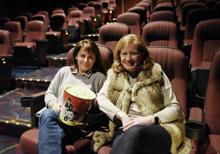 Kerry Anderson, left, of Riverside, and Michelle Howe, of Cos Cob, pose at Bow Tie Criterion Cinemas in Greenwich, Conn. Thursday, Jan. 19, 2017. The two Greenwich moms started a morning movie club to see currently-running films one morning every month. Photo: Tyler Sizemore / Hearst Connecticut Media / Greenwich Time
