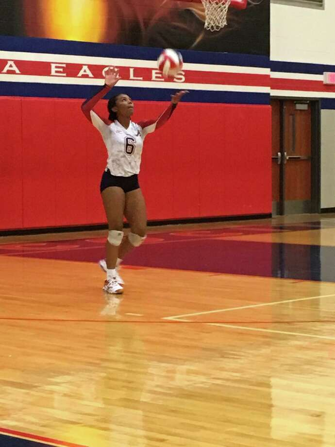 Atascocita senior setter JaNay Wooten serves the ball during the team's three-set sweep over North Shore in the opening match of district play at Atascocita High School on Tuesday, September 12 Photo: Elliott Lapin