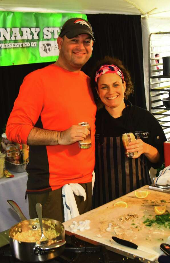 Craig Couture and Melissa Doney celebrate with a beer after competing last weekend in the finale of the Home Rangers cooking competition, held during the Saratoga Wine & Food Festival at the Saratoga Performing Arts Center. Couture, a high school teacher from Stillwater, defeated Doney, who is executive chef of Brown's Brewing in Troy. (Steve Barnes/Times Union)