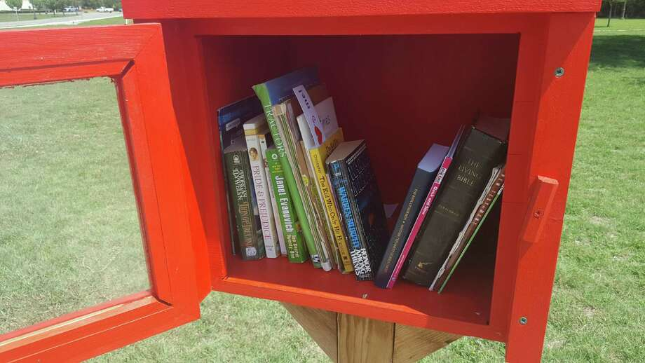 Rolling Meadows Elementary School students slow created Little Free Library, a simple box filled with books that stands in the Selma Stage Stop Park, 9374 Valhalla Street. Neighbors can freely take and drop off books in an ongoing exchange. Photo: Jeff B. Flinn / Northeast Herald / Jeff B. Flinn / Northeast Herald