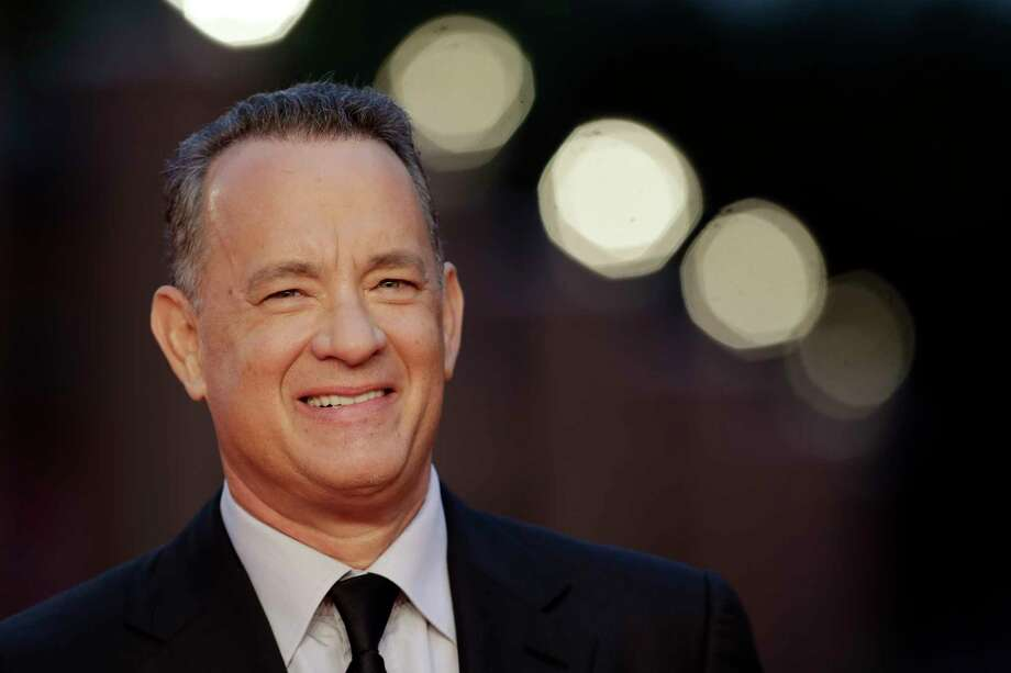 "FILE - In this Thursday, Oct. 13, 2016 file photo, actor Tom Hanks arrives to receive a lifetime achievement at the Rome Film Festival, in Rome. Within the manic action of ""Inferno,"" the latest big-screen adaptation of a Dan Brown thriller, is a warning about the dangers of seeking simple solutions to complex problems. Star Tom Hanks says it's a theme with echoes in the current U.S. presidential race. ""Inferno"" sets Hank's polymathic professor Robert Langdon on the trail of a deadly plague concocted by billionaire scientist Bertrand Zobrist (Ben Foster) out of a sort of warped humanitarianism: He plans to end war, poverty and famine by wiping out half the world's population. (AP Photo/Andrew Medichini, file) ORG XMIT: LON112 Photo: Andrew Medichini / Copyright 2016 The Associated Press. All rights reserved."
