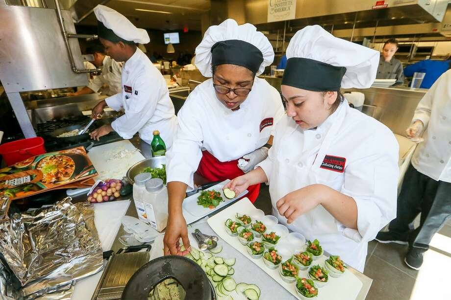 "Wagner's Mariah Sanchez (from right), 17,  culinary arts teach Rosie Laster and Kurtis Thompson, 17, work in the kitchen during the Back-to-School Cook-Off, a ""top Chef"" style competition to showcase the Culinary Arts programs in San Antonio-area ISDs, at the Culinary Institute of America, 312 Pearl Parkway, on Saturday, Sept. 9, 2017.  The culinary arts team from Wagner, representing Judson ISD, took the ""Best Overall"" award at the compeition.  MARVIN PFEIFFER/mpfeiffer@express-news.net Photo: Marvin Pfeiffer, Staff / San Antonio Express-News / Express-News 2017"