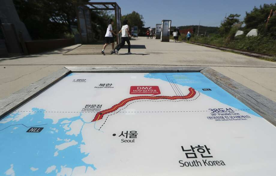 Visitors walk by the map of two Koreas at the Imjingak Pavilion in Paju, South Korea, Wednesday, Sept. 13, 2017. South Korea said Wednesday it conducted its first live-fire drill for an advanced air-launched cruise missile it says will strengthen its pre-emptive strike capability against North Korea in the event of crisis. (AP Photo/Lee Jin-man) Photo: Lee Jin-man, Associated Press