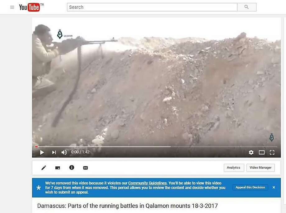 In this screen shot provided by the Shaam News Network on Sept. 12, 2017 shows a message from YouTube to the group that an uploaded video needs to be reviewed because it violates the company's community guidelines. In a sweep, hundreds of thousands of amateur videos uploaded by Syrian activists to YouTube documenting every heartbeat of the Syrian war have been removed as the tech giant applies new technology to rein in violent content on the internet, causing a panic among the activists who fear the loss of their visual history as well as evidence of human rights violations.(Shaam News Network via AP video) Photo: Associated Press