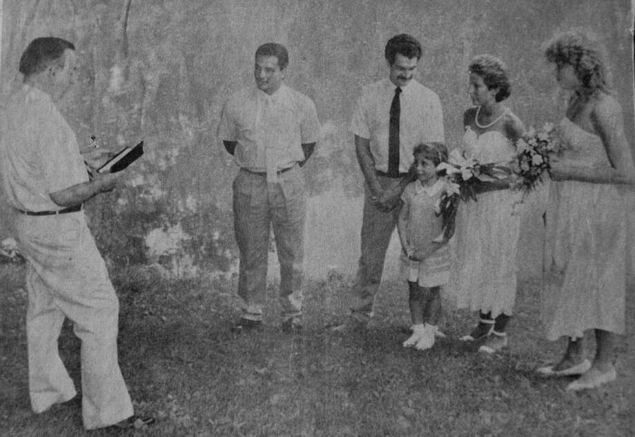 Kathy Diemer, second from right, and Gerard Diemer, third from left, on their wedding day July 11, 1987, at Harrybrooke Park in New Milford. The couple is joined in this photograph, published in the former New Milford Times, by, from left to right, the late Clifford Chapin, former selectman and mayor of New Milford, John Diemer, brother of the groom, Elizabeth Diemer, daughter of the couple and Susan Kaiser, sister of the bride. Photo: Courtesy Of Kathy Diemer