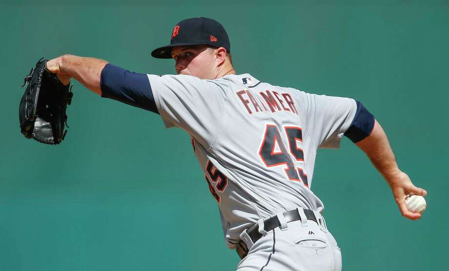 Detroit Tigers starting pitcher Buck Farmer delivers against the Cleveland Indians during the first inning in a baseball game, Wednesday, Sept. 13, 2017, in Cleveland. Photo: Ron Schwane, AP / AP 2017