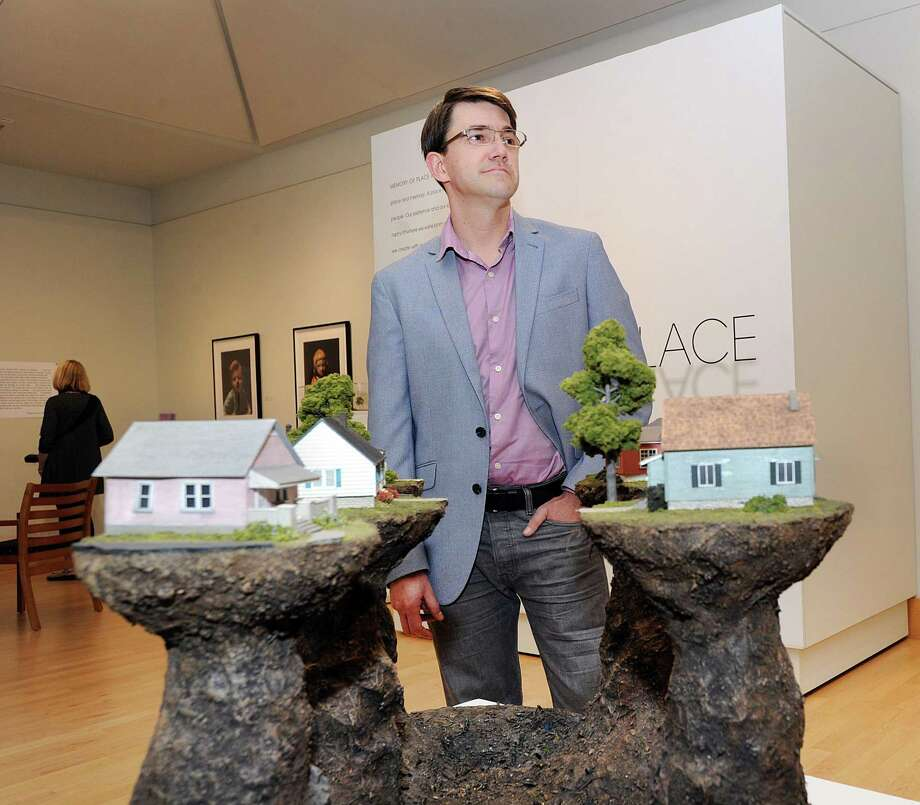 """Artist Thomas Doyle with his mixed-media 2012 work """"Proxy (Haven Ln.)"""" that is part of the new art exhibition, Memory of Place: Thomas Doyle & Frank Poor, at the Flinn Gallery located inside Greenwich Library on the second floor, Greenwich, Conn., Thursday, Sept. 7, 2017. Photo: Bob Luckey Jr. / Hearst Connecticut Media / Greenwich Time"""