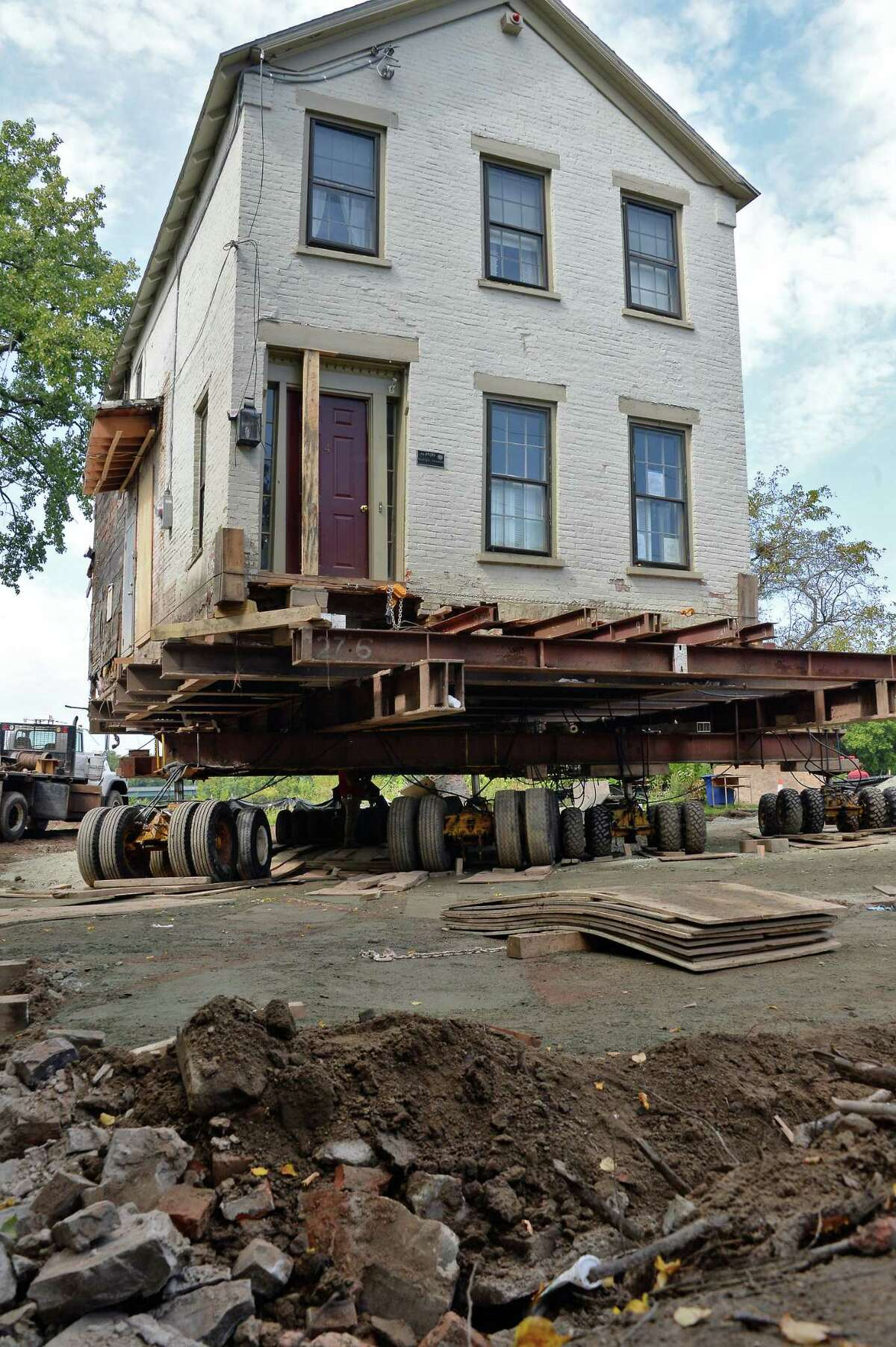 This historic 1820 Stockade home is raised up and moved back out of the flood plain Wednesday Sept. 13, 2017 in Schenectady, NY. (John Carl D'Annibale / Times Union)