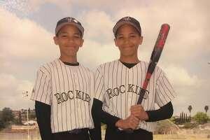 Alijah (left) and Mikah Holder as Little Leaguers.