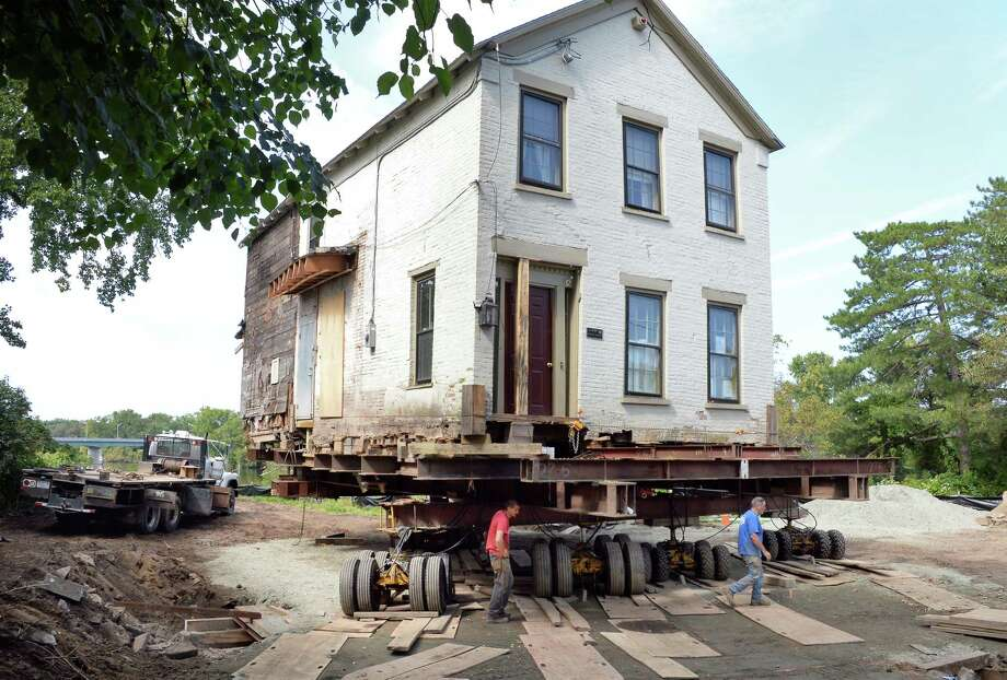 This historic 1820 Stockade home is raised up and moved back out of the flood plain Wednesday Sept. 13, 2017 in Schenectady, NY.  (John Carl D'Annibale / Times Union) Photo: John Carl D'Annibale, Albany Times Union / 40041543A