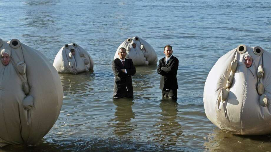 """Andy Bichlbaum, left, and Mike Bonanno, the Yes Men, with their """"Survivaballs."""" Photo: Courtesy Of The Artists"""