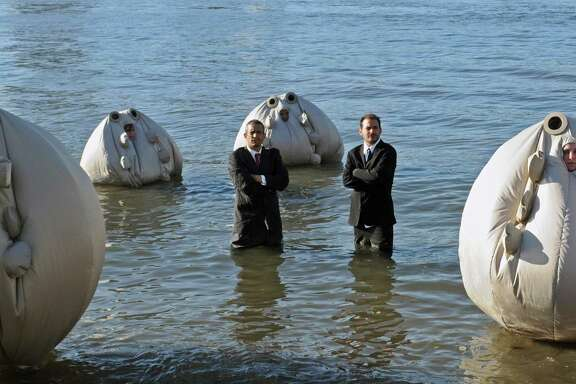 """Andy Bichlbaum, left, and Mike Bonanno, the Yes Men, with their """"Survivaballs."""""""