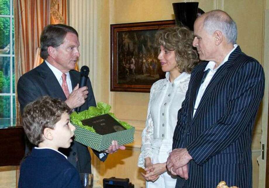 June 14, 2010 -- The Greenwich Historical Society added Treetops, the historic home of Lisa and Don Brownstein in Cos Cob, to the Greenwich Landmarks Registry at a cocktail reception on June 9. From left: David Ogilvy presents the plaque to the Brownsteins. Photo: Contributed Photo / Greenwich Time Contributed