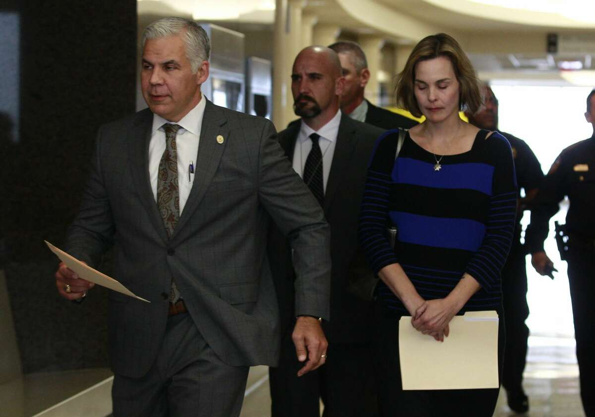 Montgomery County District Attorney Brett Ligon, left arrives at a courtroom with Kathleen Goforth, widow of Harris County Sheriff's Deputy Darren Goforth, at the Harris County Civil Courthouse, Wednesday, Sept. 13, 2017, in Houston. Shannon Miles, 32, pleaded guilty to capital murder and was sentenced to life without parole for fatally shooting Harris County Sheriff's Deputy Darren Goforth on Aug. 28, 2015, as he was filling up his patrol car at a gas station in Northeast Harris County.