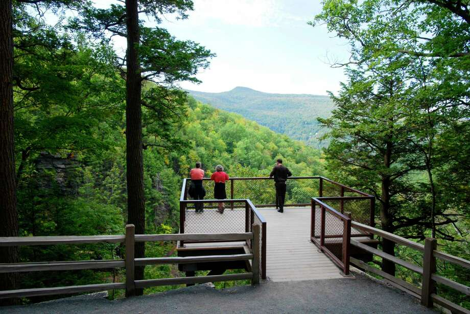 People stand on the observation platform that overlooks  Kaaterskill Falls on Wednesday, Sept. 13, 2017, in Hunter, N.Y.     (Paul Buckowski / Times Union) Photo: PAUL BUCKOWSKI, Albany Times Union / 40041523A