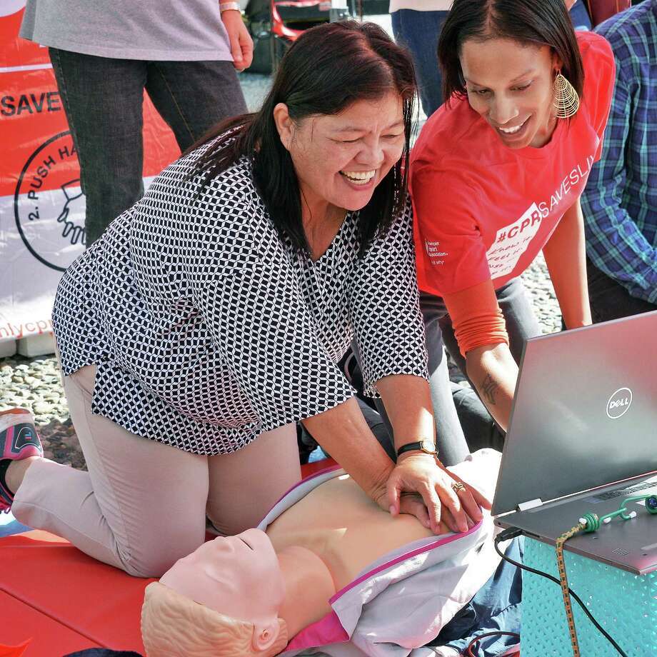 Aurora Reoal, left, works with instructor Krystal Murray as the Hands-Only CPR Mobile Tour holds classes on the Empire State Plaza Wednesday Sept. 13, 2017 in Albany, NY.  (John Carl D'Annibale / Times Union) Photo: John Carl D'Annibale, Albany Times Union / 40041517A