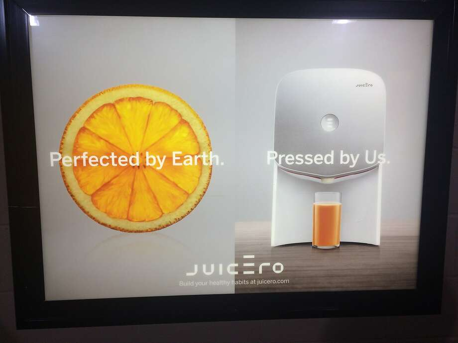 An ad at AT&T Park advertises Juicero, which has gone out of business after having trouble raising funds to design a cheaper Internet-connected juice press. Photo: Karen Petterson / The Chronicle