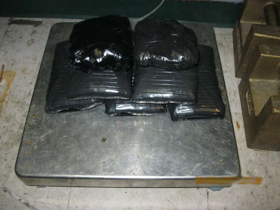 Border Patrol agents allegedly seized these bundles taped to a man at the Sarita Checkpoint.
