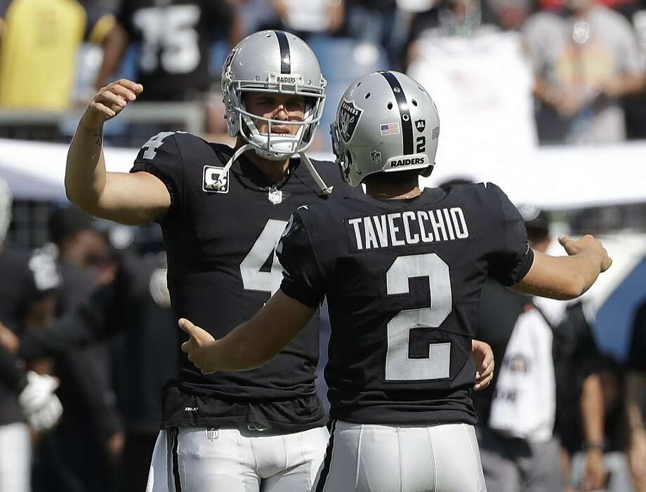 Oakland Raiders kicker Giorgio Tavecchio (2) celebrates with quarterback Derek Carr (4) after Tavecchio kicked a a 43-yard field goal against the Tennessee Titans in the fourth quarter of an NFL football game Sunday, Sept. 10, 2017, in Nashville, Tenn. The field goal was the fourth of the game for Tavecchio. The Raiders won 26-16. (AP Photo/James Kenney) Photo: James Kenney, Associated Press